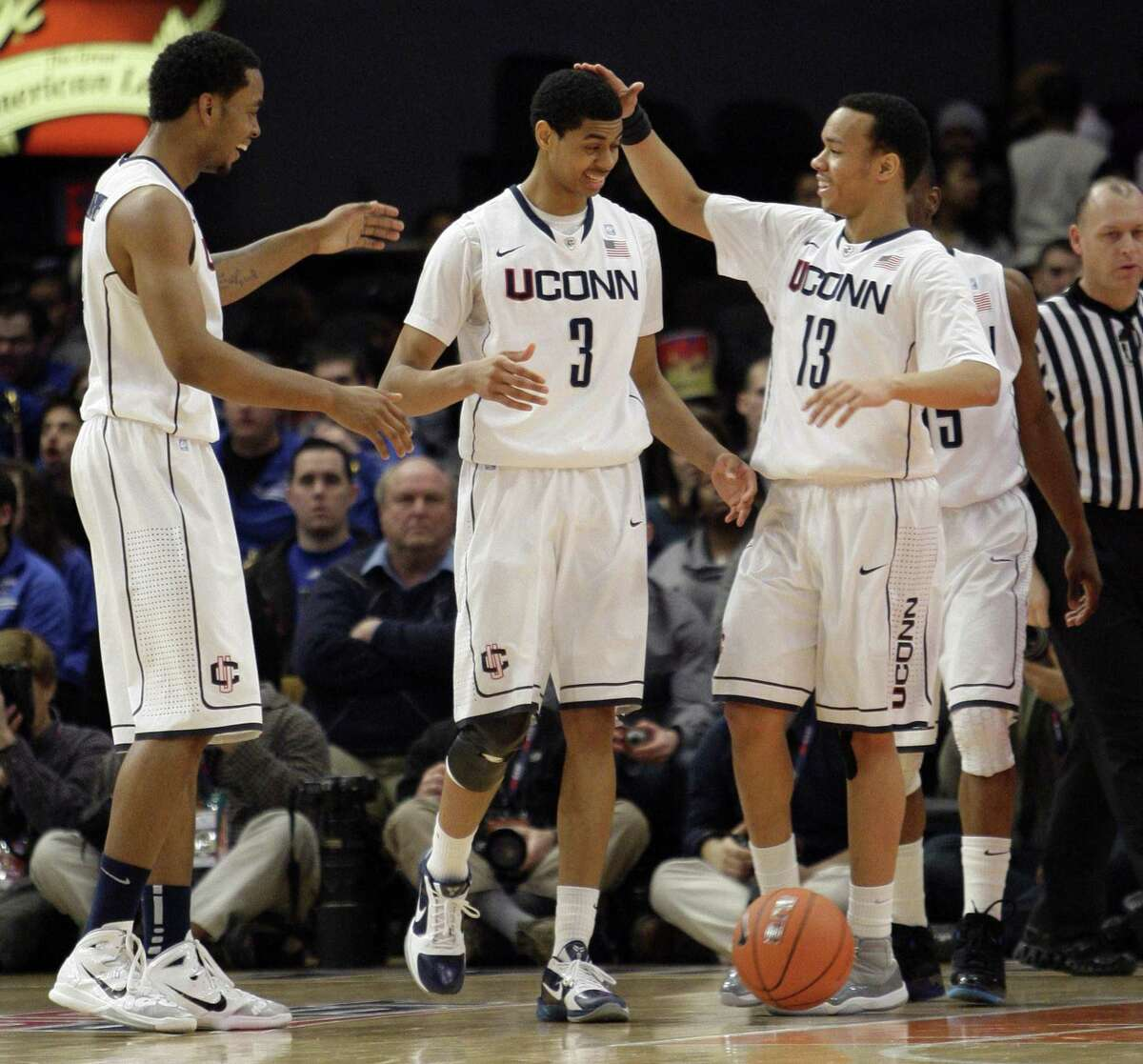 Connecticut's Jeremy Lamb (3) celebrates a basket with teammates Shabazz Napier (13) and Jamal Coombs-McDaniel during the first half of an NCAA college basketball game against DePaul at the Big East Championship, Tuesday, March 8, 2011 at Madison Square Garden in New York. (AP Photo/Mary Altaffer)