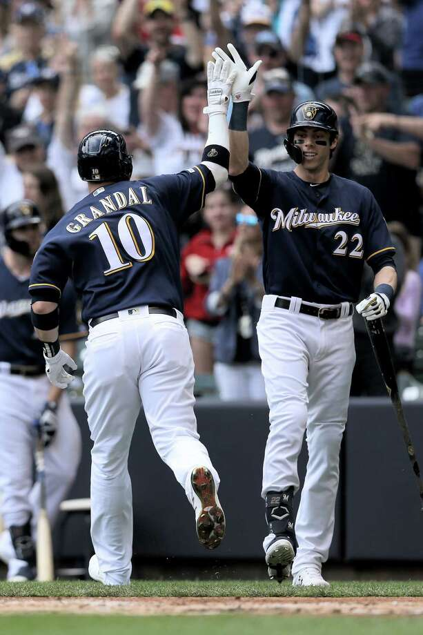 MILWAUKEE, WISCONSIN - JUNE 22:  Yasmani Grandal #10 and Christian Yelich #22 of the Milwaukee Brewers celebrate after Grandal hit a home run in the first inning against the Cincinnati Reds at Miller Park on June 22, 2019 in Milwaukee, Wisconsin. (Photo by Dylan Buell/Getty Images) Photo: Dylan Buell / 2019 Getty Images