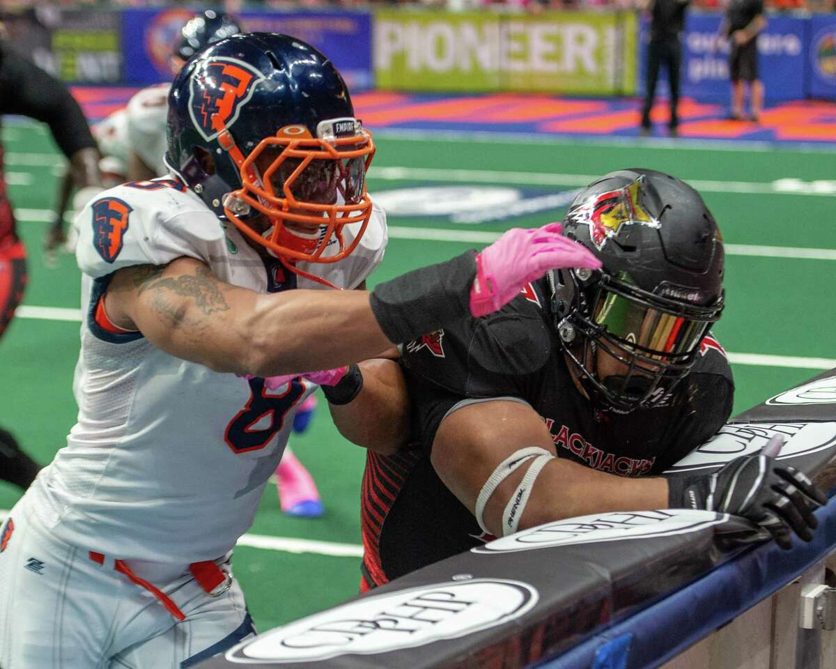 Albany Empire Terence Moore tackles Atlantic Blackjack wide receiver Lamark Brown at the Times Union Center on Saturday, June 22, 2019 (Jim Franco/Special to the Times Union.)