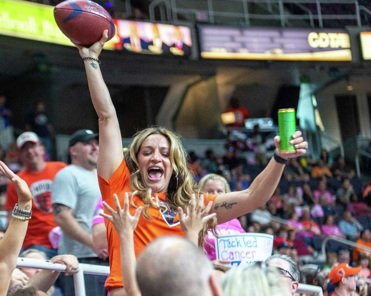 Albany Empire fan Brittany Burnham celebrates after catching a ball that flew out of bounds during a game against Atlantic City. There will be a limit of about 3,500 fans for the opener this week.