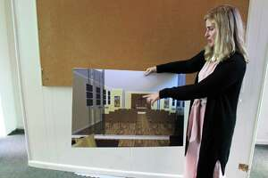Malta House Executive Director Carey Doughtery shows off a rendering for a renovated chapel at Malta House's newly approved location on West Rocks Road on Thursday, June 20, 2019.