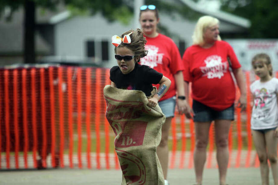 Isabel Glisson takes no prisoners during relay races at the Ashland Summer Days festival Saturday at James Park. Photo: Rosalind Essig | Journal-Courier