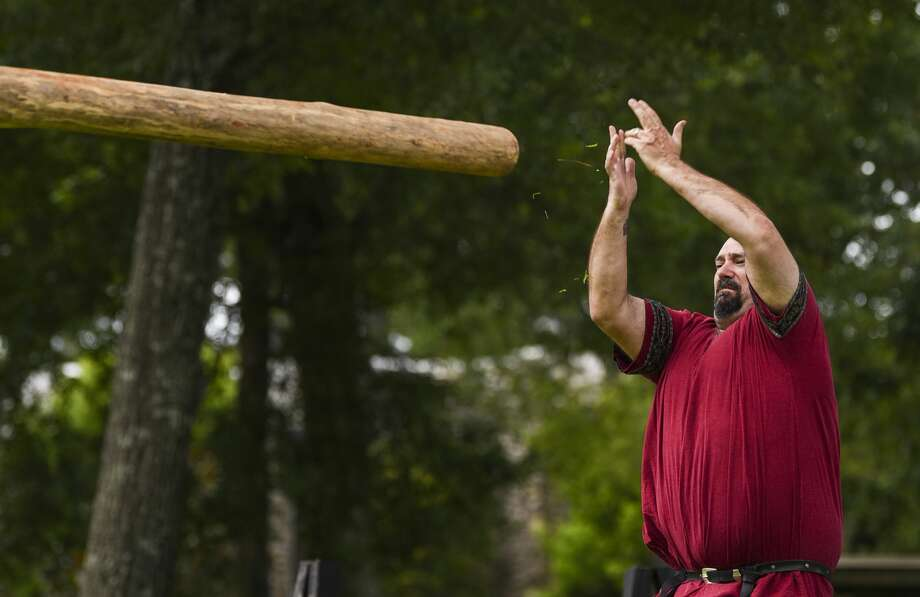 Jonathan Lockwood of Lexington, who goes by Edric Haldyn, throws a log during the caber toss event the Bordermarch Baronial Highland Games at St. Stephen's Episcopal Church Saturday afternoon. The event was put on by the Society for Creative Anachronism. The group, which is also known as SCA, research and recreate ways of life before the 17th century. Beaumont is located in the Ansteorra, Swedish for Lone Star, kingdom which includes Texas and Oklahoma. SCA members participate in many different events including making their own armor, chivalric fighting, archery and textile production. While many members choose to follow medieval Europe ideas some choose instead vikings or samurais. Photo taken on Saturday, 06/22/19. Ryan Welch/The Enterprise Photo: Ryan Welch/The Enterprise