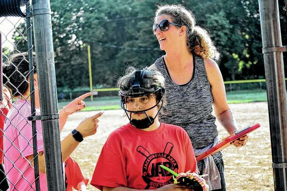 Coach Amy Bordean makes preparations before a JAB Softball game earlier this week.