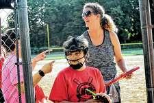 Coach Amy Bordean makes preparations before a JAB Softball game earlier this week.