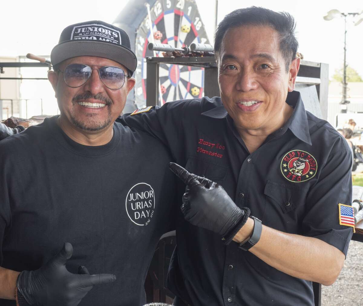 """Junior Urias, Pitmaster from Midland, TX, and Harry Soo, Pitmaster from California, joke they are """"brothers from a different mother"""" 06/22/19 evening during the Junior Urias Day celebration at Up in Smoke. Tim Fischer/Reporter-Telegram"""