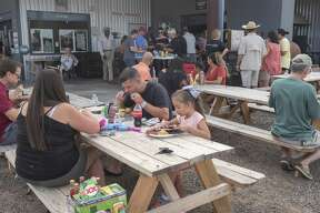 Patrons enjoy an evening of great BBQ, music, and fun 06/22/19 during the Junior Urias Day celebration at Up in Smoke. Tim Fischer/Reporter-Telegram