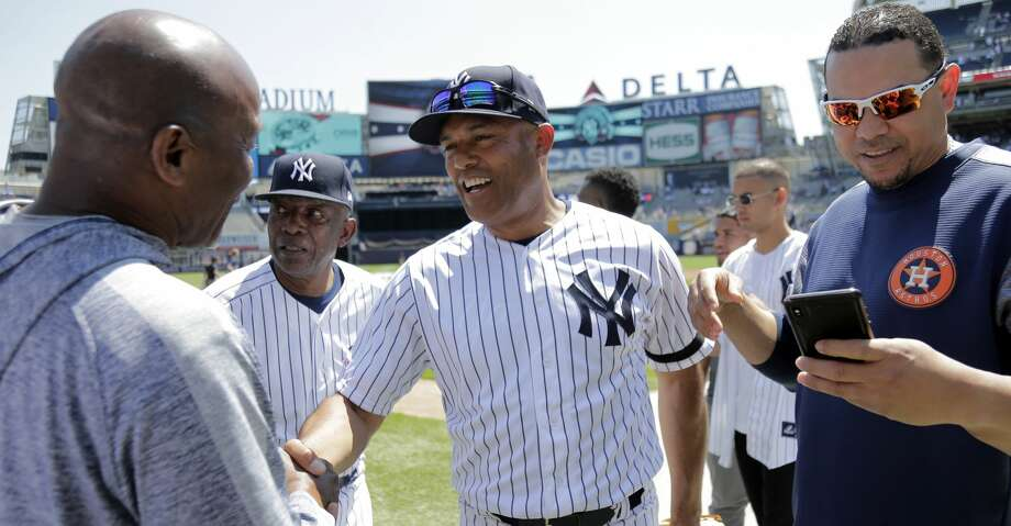 Former New York Yankees player Mariano Rivera, center, greets people on the field during Old Timers' Day at Yankee Stadium, Sunday, June 23, 2019, in New York. (AP Photo/Seth Wenig) Photo: Seth Wenig/Associated Press