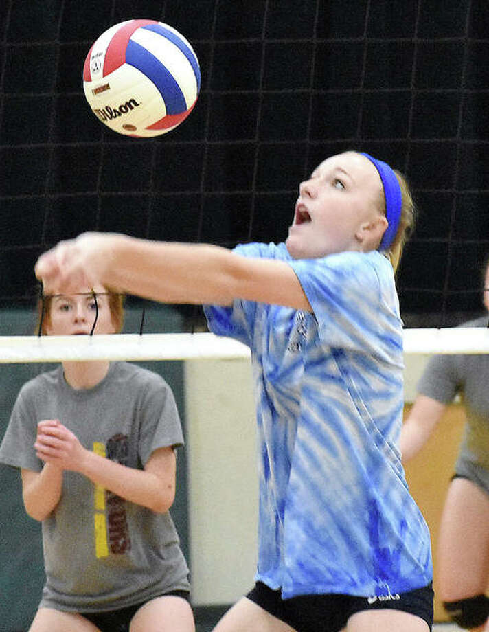 Marquette Catholic junior middle hitter Emma Menke, above, keeps her eye on the ball in action against East Alton-Wood River Saturday at the Metro-East Lutheran Summer Slam in Edwardsville. Teams from all over the Riverbend took part in the Summer Slam. Marquette went 4-1 on the day, defeating EA-WR 25-20, 25-13; Civic Memorial 21-25, 25-10, 15-10; MELHS 25-13, 25-18; losing to Roxana 12-25, 22-25 and defeating Bunker Hill 25-15, 25-14. Photo: Matt Kamp | Hearst Illinois