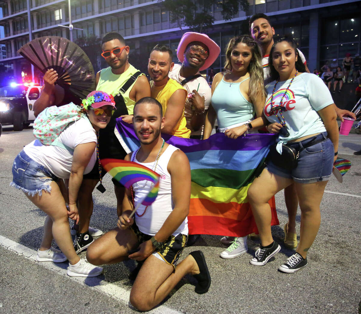 People pose for photos at the 2019 Houston Pride Parade in Downton Houston, Saturday, June 22, 2019.