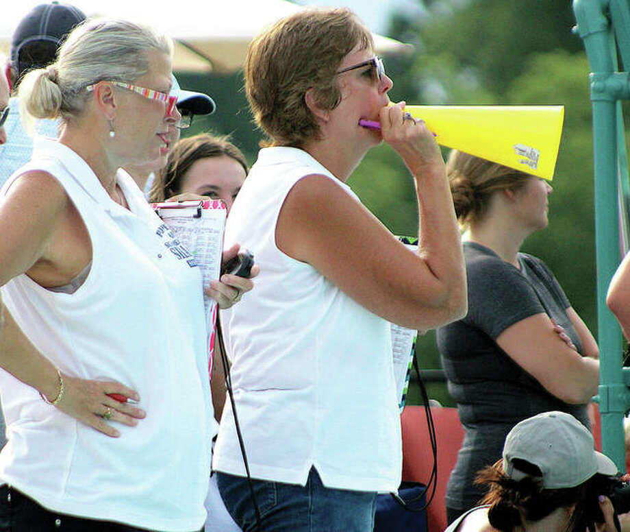 Summers Port head coach Nancy Miller uses a megaphone to shout to her swimmers at the 2018 SWISA Relays at Sunset Hills. At left is assistant coach Jennifer Roth. Photo: Pete Hayes File Photo | The Telegraph