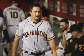 San Francisco Giants' Alex Dickerson walks through the dugout after scoring a run against the Arizona Diamondbacks during the third inning of a baseball game Saturday, June 22, 2019, in Phoenix. (AP Photo/Ross D. Franklin)