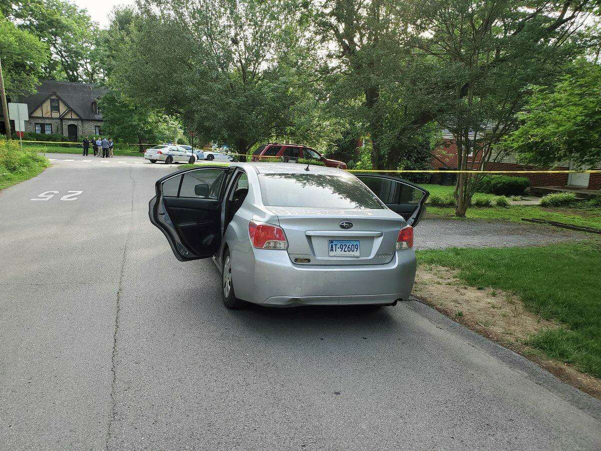A photo from the crime scene of a stabbing attack on Cherokee Road in Nashville, Tenn., on Friday, June 21, 2019, that shows a vehicle with Connecticut plates that police said belongs to the suspect.Police have obtained an arrestwarrant, chargingKent resident Peter Alexander Bohning, 34, with murder and attempted murder.