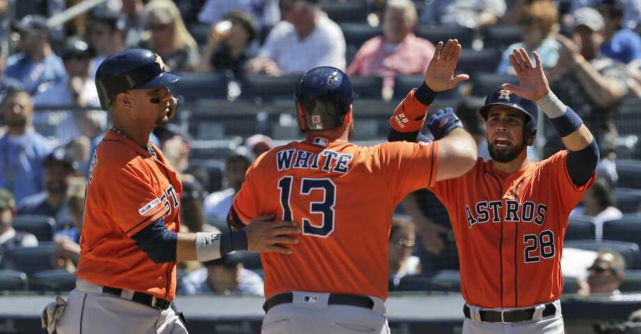 Houston Astros' Robinson Chirinos, right, and Yuli Gurriel, left, celebrate Tyler White's (13) grand slam during the fourth inning of a baseball game against the New York Yankees at Yankee Stadium, Sunday, June 23, 2019, in New York. (AP Photo/Seth Wenig) Photo: Seth Wenig/Associated Press