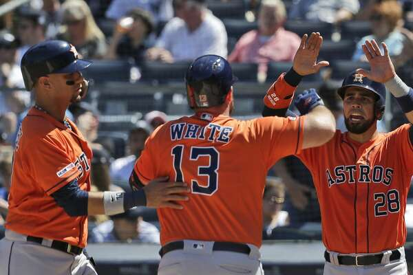 Houston Astros' Robinson Chirinos, right, and Yuli Gurriel, left, celebrate Tyler White's (13) grand slam during the fourth inning of a baseball game against the New York Yankees at Yankee Stadium, Sunday, June 23, 2019, in New York. (AP Photo/Seth Wenig)