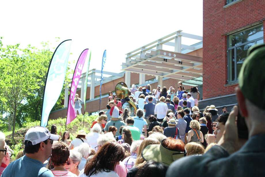 Hundreds enter the newly renovated Westport Library at its grand reopening on June 23, 2019. Photo: Melanie Espinal / For Hearst Connecticut Media