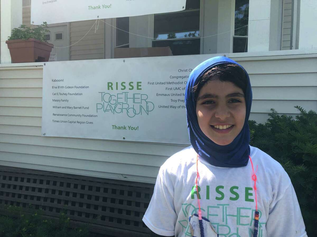 Fatema Alshaar, an eight-year-old resettled as a refugee from Jordan, helped build a new playground that she uses at newcomer welcome non-profit organization Refugee and Immigrant Support Services of Emmaus (RISSE) in Albany, N.Y. on Sunday, June 23, 2019.