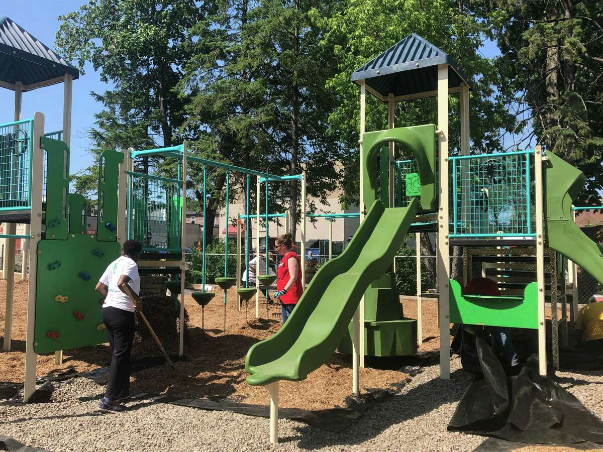 Volunteers from churches, temples, businesses and local organizations put the finishing touches on a new playground at newcomer welcome non-profit organization Refugee and Immigrant Support Services of Emmaus (RISSE) in Albany, N.Y. on Sunday, June 23, 2019.