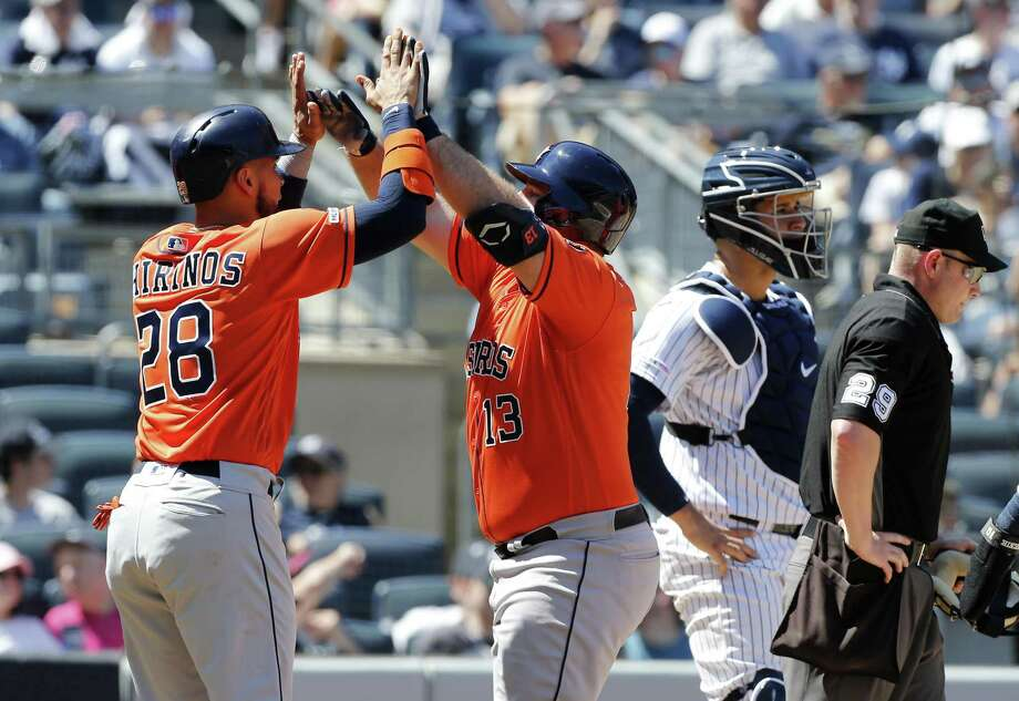 Tyler White (13) of the Houston Astros celebrates his fourth inning grand slam home run against the New York Yankees with teammate Robinson Chirinos (28) at Yankee Stadium on June 23, 2019 in New York City. Photo: Jim McIsaac, Stringer / Getty Images / 2019 Getty Images