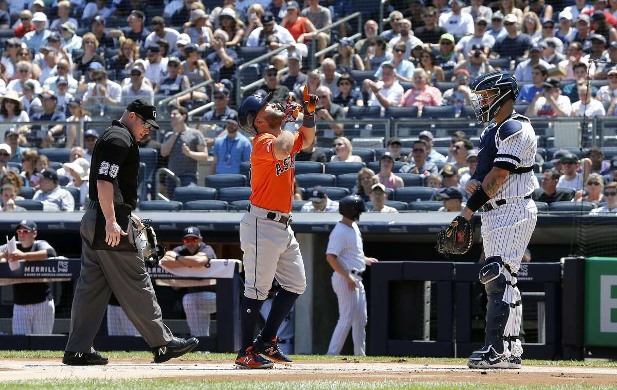 NEW YORK, NEW YORK - JUNE 23: Jose Altuve #27 of the Houston Astros reacts at home plate after his first inning home run as Gary Sanchez #24 of the New York Yankees looks on at Yankee Stadium on June 23, 2019 in New York City. (Photo by Jim McIsaac/Getty Images)