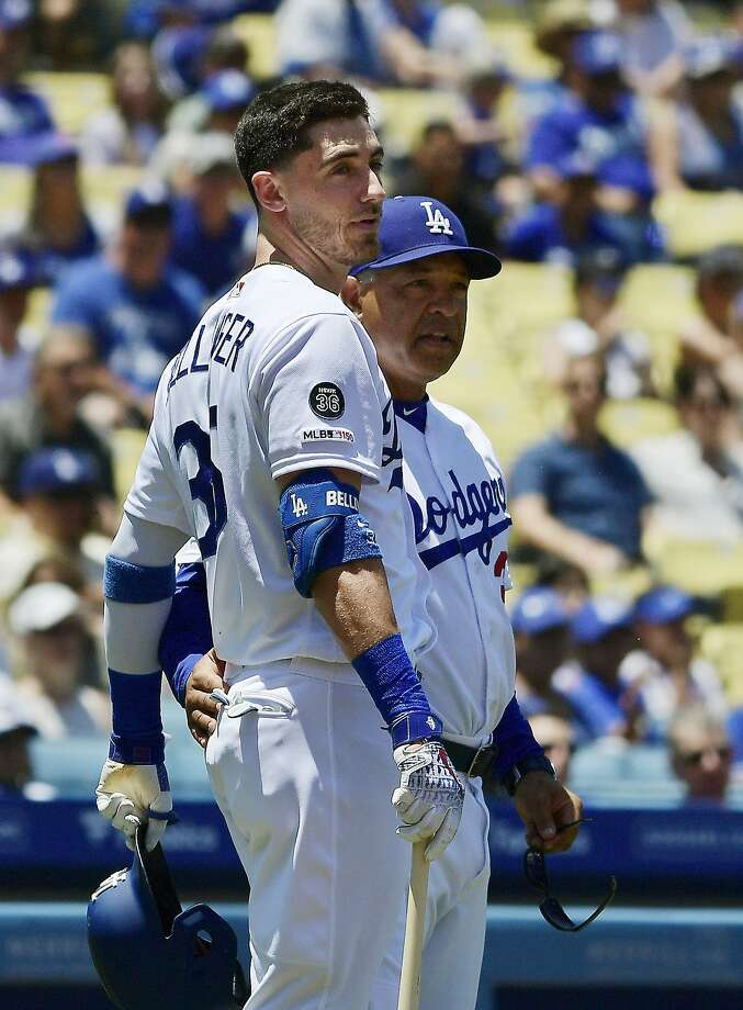 Los Angeles Dodgers manager Dave Roberts, right, talks with Cody Bellinger after Bellinger hit a fan with a foul ball during the first inning of a baseball game against the Colorado Rockies, Sunday, June 23, 2019, in Los Angeles. (AP Photo/Mark J. Terrill) Photo: Mark J. Terrill, Associated Press