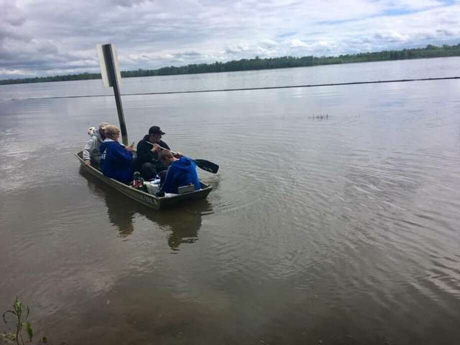 Employees of the Raging Rivers Waterpark outside of Grafton use a jon boat to access the park due to flooding. The park now plans to open July 3. Photo: For The Telegraph