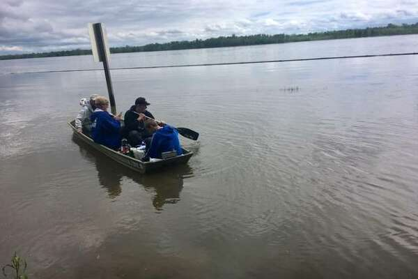 Employees of the Raging Rivers Waterpark outside of Grafton use a jon boat to access the park due to flooding. The park now plans to open July 3.