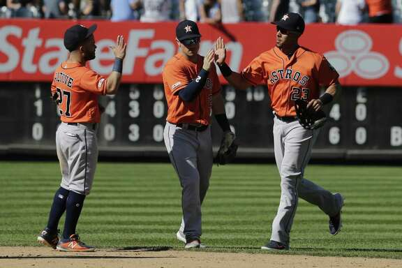 Houston Astros' Michael Brantley, right, Alex Bregman, center, and Jose Altuve celebrate after a baseball game against the New York Yankees at Yankee Stadium, Sunday, June 23, 2019, in New York. (AP Photo/Seth Wenig)