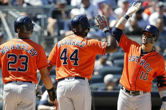NEW YORK, NEW YORK - JUNE 23:   Yordan Alvarez #44 of the Houston Astros celebrates his fifth inning two run home run against the New York Yankees with teammates Michael Brantley #23 and Yuli Gurriel #10 at Yankee Stadium on June 23, 2019 in New York City. (Photo by Jim McIsaac/Getty Images)