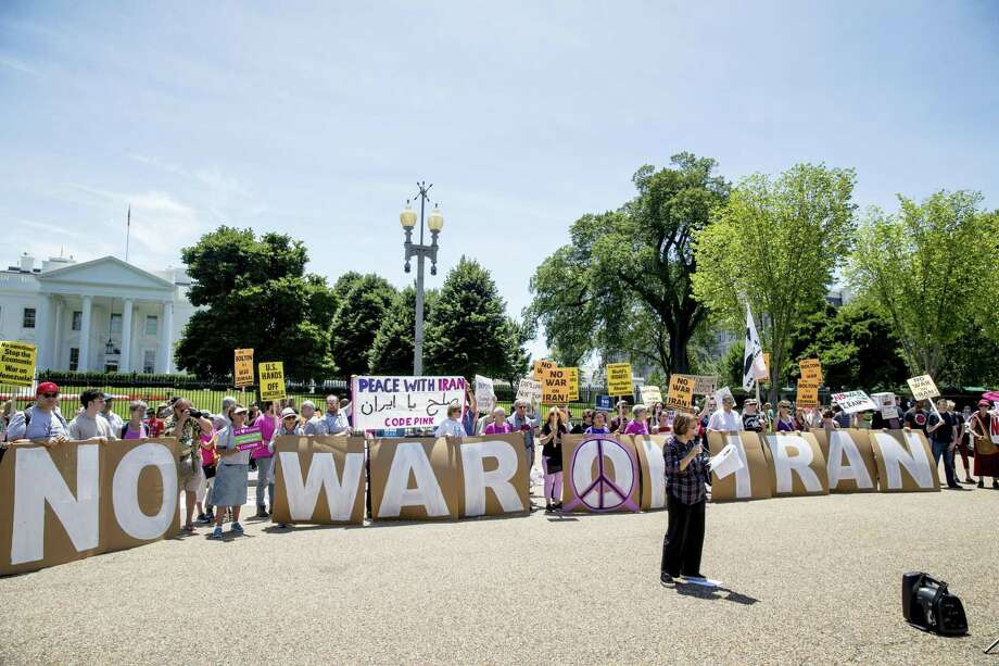 Iranian poet Fatemeh Keshavarz speaks as members of the ANSWER Coalition hold an anti-war with Iran rally outside of the White House in Washington, Sunday, June 23, 2019. (AP Photo/Andrew Harnik) Photo: Andrew Harnik, STF / Associated Press / Copyright 2019 The Associated Press. All rights reserved