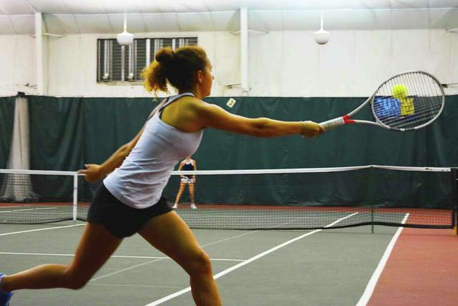 Sophie Bly of St. Louis returns a practice serve from Suzanna McLellan of St. Louis, before tournament play on day three of the Tiger Classic. Photo: Tyler Pletsch | The Intelligencer