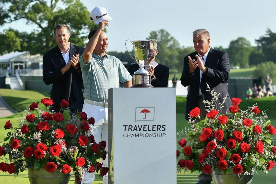 Chez Reavie salutes the crown after winning the Travelers Championship on Sunday. Photo: Gregory Vasil / For Hearst Connecticut Media / Connecticut Post Freelance