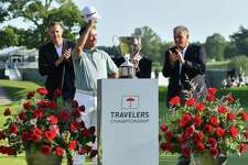 Chez Reavie salutes the crown after winning the Travelers Championship on Sunday.