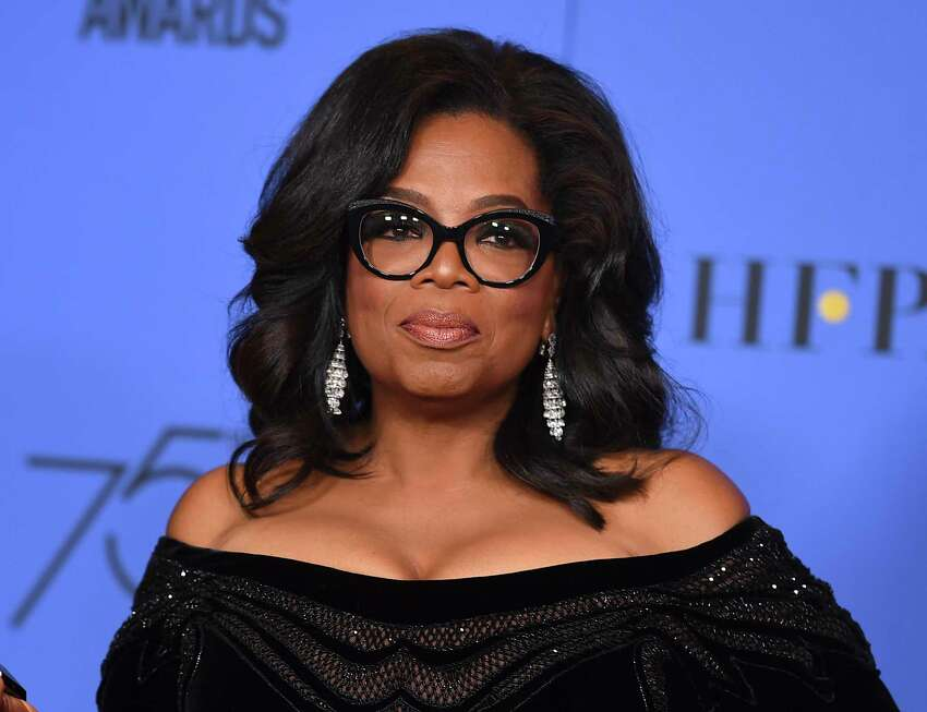 FILE - In this Jan. 7, 2018 file photo, Oprah Winfrey poses in the press room with the Cecil B. DeMille Award at the 75th annual Golden Globe Awards in Beverly Hills, Calif. Winfrey will interview two men who say Michael Jackson sexually abused them as boys immediately after a documentary on the men. HBO and the Oprah Winfrey Network announced Wednesday that ?After Neverland,? will air on both channels Monday at 10 p.m. Eastern and Pacific. (Photo by Jordan Strauss/Invision/AP, File)
