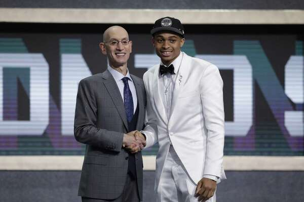 Keldon Johnson, right, stands with NBA Commissioner Adam Silver after the Kentucky forward was selected with the 29th pick overall. He played one year for the Wildcats, earning freshman of the year honors in the Southeastern Conference.