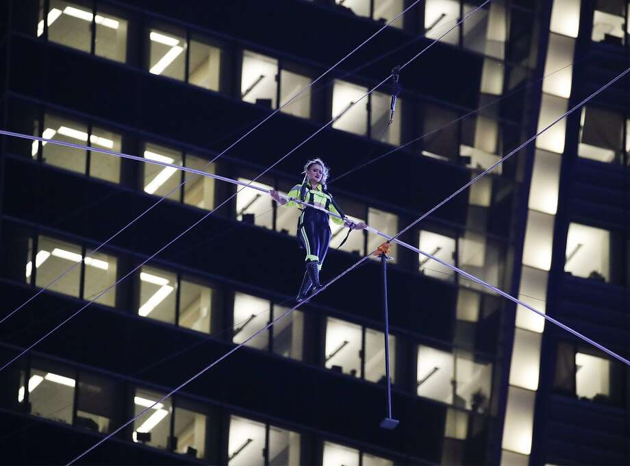 Aerialist Lijana Wallenda walks on a high wire above Times Square, Sunday, June 23, 2019, in New York. (AP Photo/Jason Szenes) Photo: Jason Szenes, Associated Press