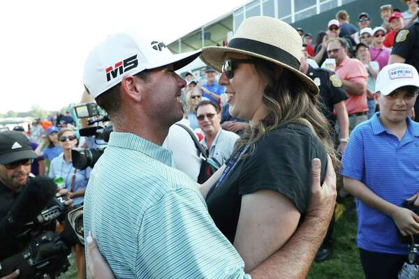 Chez Reavie celebrates with wife Amanda Henrichs after winning the Travelers Championship on Sunday in Cromwell.