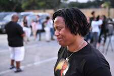 Jeanelle Cornelius smiles while recalling her son, 25 year old Brandon Cornelius who was murdered one year ago, during a candlelight vigil Sunday evening.His assailants haven't been found. The vigil took place at the site of Cornelius' murder, The Ridge Shopping Center. Photo by Robin Jerstad:correspondent