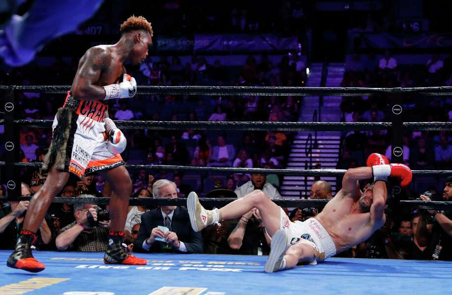 PHOTOS: More from Jermell Charlo's knockout win over Jorge Cota Jermell Charlo knocks down Jorge Cota, of Mexico, in a junior middleweight boxing match Sunday, June 23, 2019, in Las Vegas. (AP Photo/John Locher) Photo: John Locher, Associated Press / Copyright 2019 The Associated Press. All rights reserved.