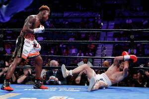 Jermell Charlo knocks down Jorge Cota, of Mexico, in a junior middleweight boxing match Sunday, June 23, 2019, in Las Vegas. (AP Photo/John Locher)