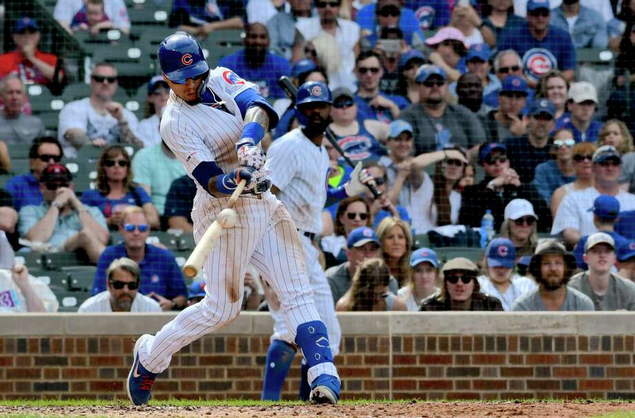 Chicago Cubs' Javier Baez (9) hits a three run home run during the eighth inning of a baseball game against the New York Mets Sunday, June 23, 2019, in Chicago. (AP Photo/Matt Marton) Photo: Matt Marton / Copyright 2019 The Associated Press. All Rights Reserved.