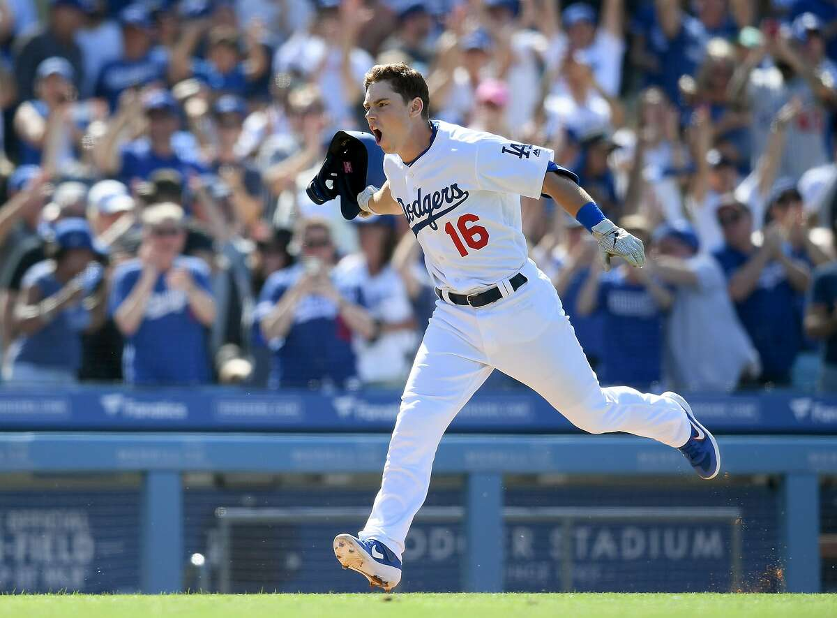 LOS ANGELES, CALIFORNIA - JUNE 23: Will Smith #16 of the Los Angeles Dodgers celebrates his walk-off two run homerun, for a 5-3 win over the Colorado Rockies, during the ninth inning at Dodger Stadium on June 23, 2019 in Los Angeles, California. (Photo by Harry How/Getty Images)