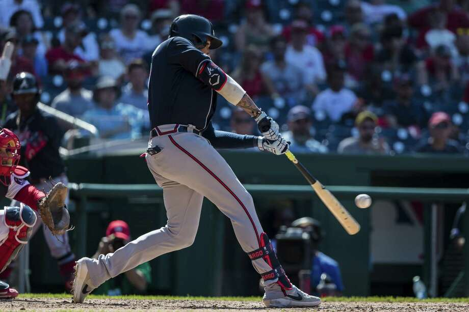 WASHINGTON, DC - JUNE 23: Johan Camargo #17 of the Atlanta Braves hits a two-run home run against the Washington Nationals during the tenth inning at Nationals Park on June 23, 2019 in Washington, DC. (Photo by Scott Taetsch/Getty Images) Photo: Scott Taetsch / 2019 Getty Images