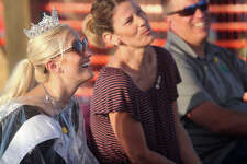 Mallory Erickson watches the action at the demolition derby at the Western Illinois Fair Saturday with her parents, Dirk and Stacey Erickson.