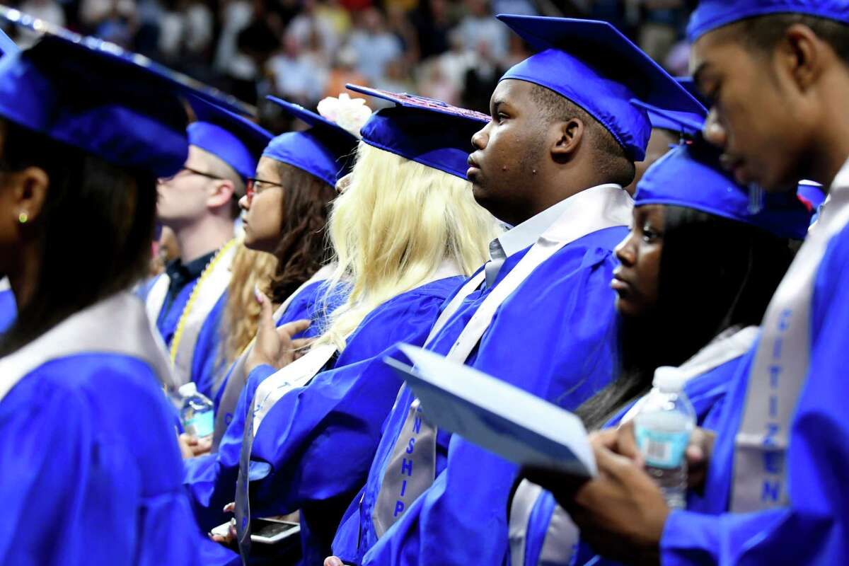 Albany High School seniors stand to graduate during the 149th commencement exercises on Sunday, June 23, 2019, at the Times Union Center in Albany, N.Y. (Catherine Rafferty/Times Union)