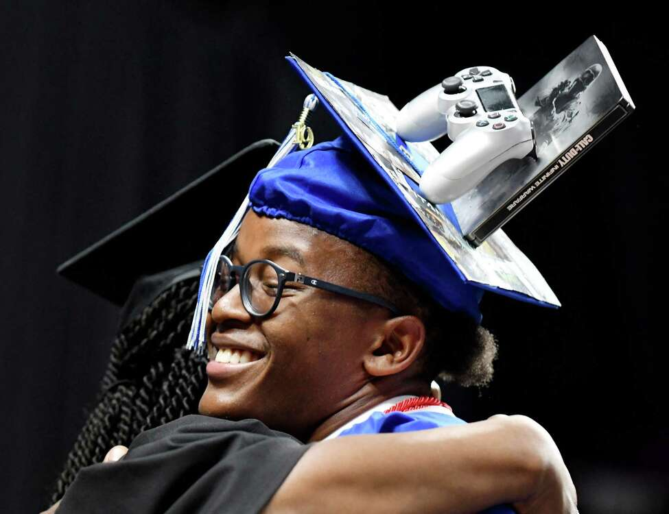 Jaden Gary hugs Kaweeda G. Adams, superintendent of Albany schools, during the 149th commencement of Albany High School on Sunday, June 23, 2019, at the Times Union Center in Albany, N.Y. (Catherine Rafferty/Times Union)