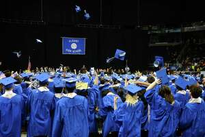 Albany High School graduates throw their graduation caps at the conclusion of the 149th commencement on Sunday, June 23, 2019, at the Times Union Center in Albany, N.Y. (Catherine Rafferty/Times Union)