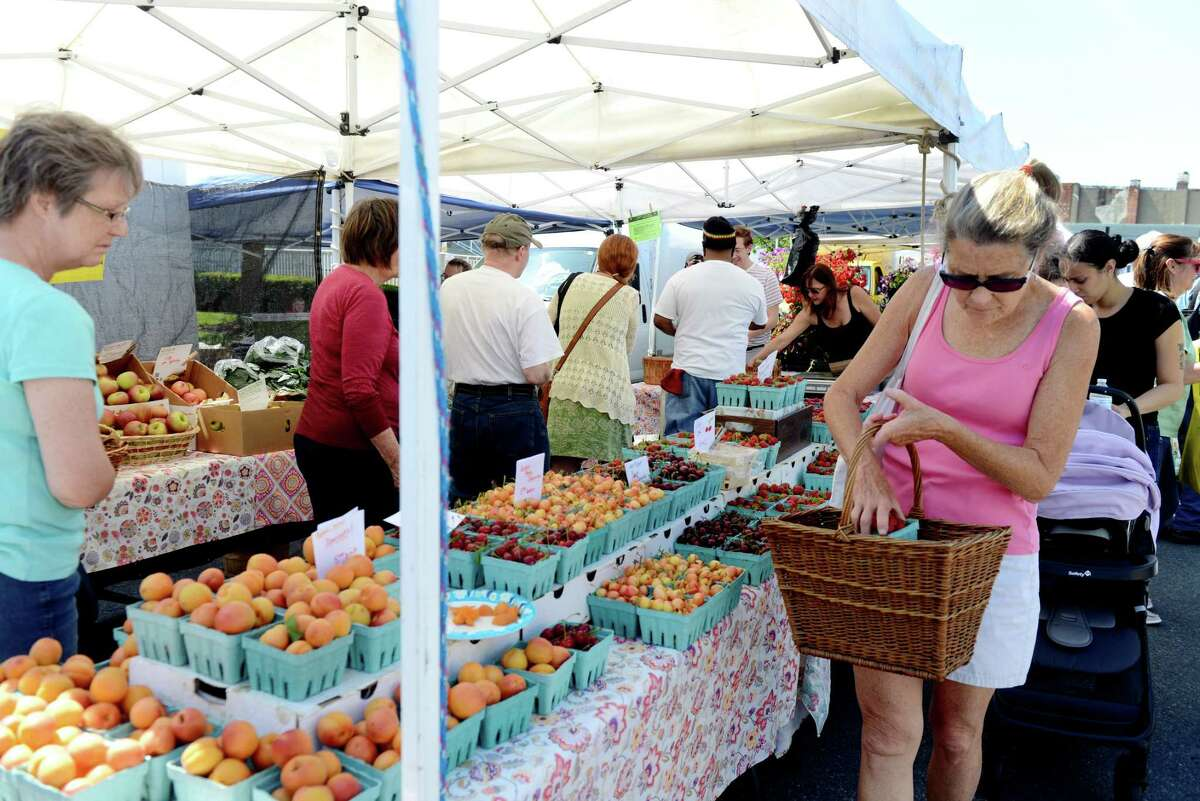 A long line forms at the Maynard Farms of Ulster, N.Y. stall at the Schenectady Greenmarket on Sunday, June 23, 2019, in Schenectady, N.Y. (Catherine Rafferty/Times Union)