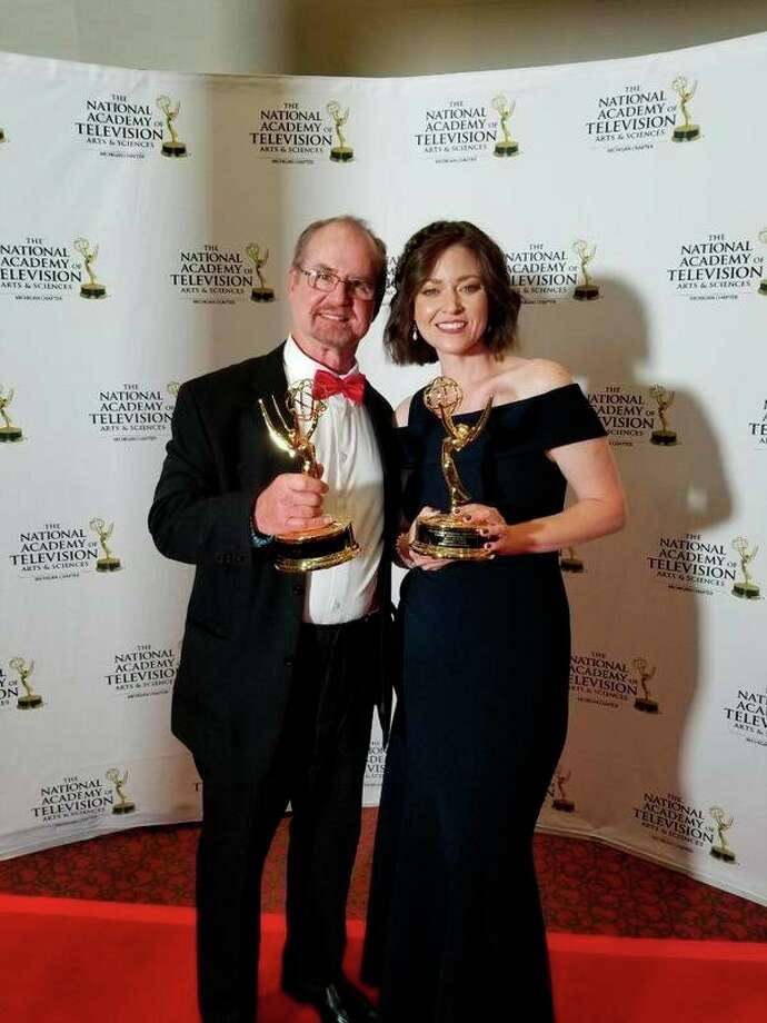 Co-producers Ken LaPlace, a retired Pontiac police detective, and Kimberly Wells, associate professor of Electronic Media at Delta College, pose with the Emmy Awards that were presented to them on June 15 in Detroit for their documentary, 'Two Brothers.' The film chronicles the struggles of two Michigan police officers after they both survived being shot in the head in separate incidents. (photo provided)
