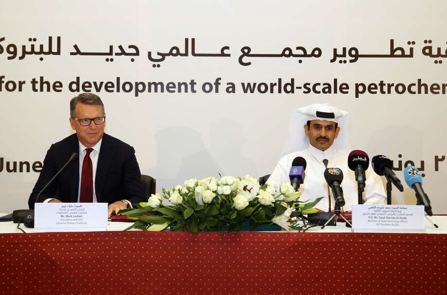 From left: Mark Lashier, president and CEO of Chevron Phillips Chemical Company LLC, sits beside His Excellency Mr. Saad Sherida Al-Kaabi, the Minister of State for Energy Affairs and the President & CEO of Qatar Petroleum, during a joint press conference today, June 24, 2019 announcing the signing of an agreement to pursue the development, construction and operation of a petrochemicals complex in Qatar. Photo credit: Qatar Petroleum. Photo: Courtesy Photo